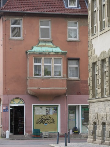 Arabic calligraphy on a shop window in the town of Dessau