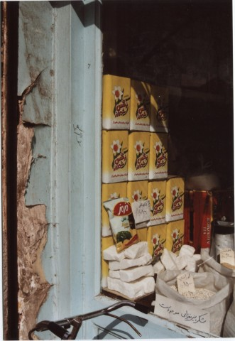 Oil in metal containers with narcissus  in a shop in Tabriz